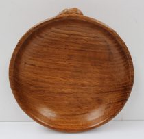 """A Robert Thompson of Kilburn """"Mouseman"""" shallow bowl, with trademark mouse on the outside edge, 18cm diameter. Sold for £120 at Anthemion Auctions"""