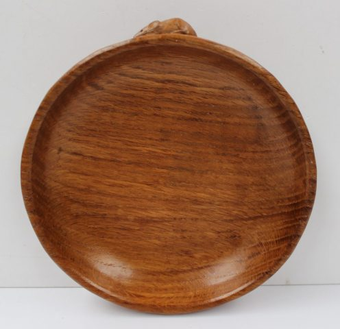 "A Robert Thompson of Kilburn ""Mouseman"" shallow bowl, with trademark mouse on the outside edge, 18cm diameter. Sold for £120 at Anthemion Auctions"