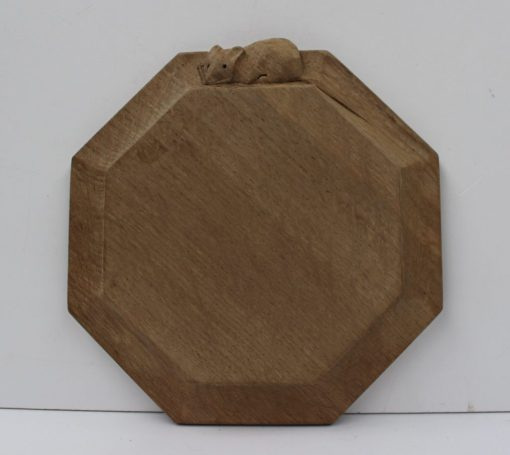 """A Robert Thompson of Kilburn """"Mouseman""""octagonal cheese board, with trademark mouse on the outside edge, 19cm wide. Sold for £85 at Anthemion Auctions"""