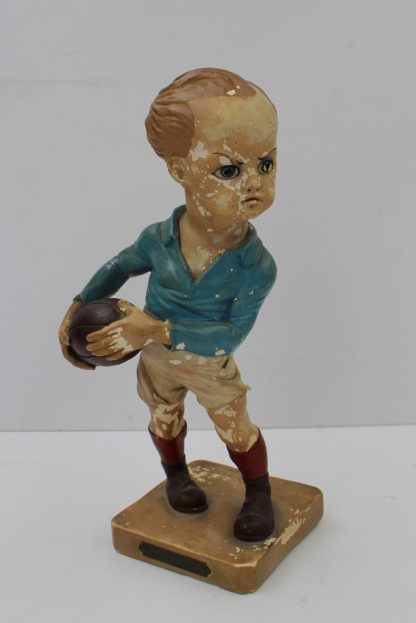 "A 1924 Olympic rugby figure: a plaster rugby figure of a French rugby player wearing French colours by the French artist E Coffin - produced and designed to celebrate the Paris Olympic Games in 1924 - mounted on a rectangular base c/w brass plaque inscribed ""VIIIth Olympiade Paris 1924 - Le Rugby par Coffin"", 27.5cm high. Sold for £520 at Anthemion Auctions"