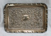 An Edward VII silver dressing table tray of rectangular form, embossed with scrolls and leaves, Birmingham, 1904, approximately 220 grams. Sold for £75 at Anthemion Auctions.