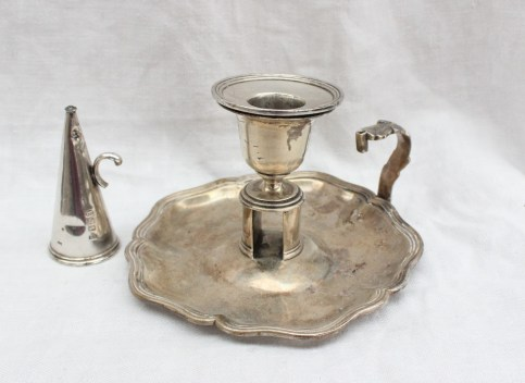A late George III silver chamber stick, with a shaped line decorated edge, with removable sconce and extinguisher, London, 1827, Benjamin Smith III, approximately 194 grams. Sold for £160 at Anthemion Auctions