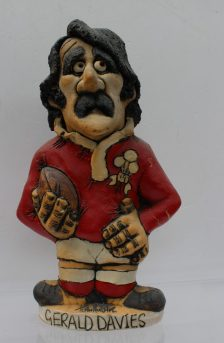 A John Hughes pottery Grogg of Gerald Davies, in a Welsh jersey with a ball under his arm and the No.14 on the reverse, signed and dated 1979 to the base, 25cm high. Sold for £221 at Anthemion Auctions