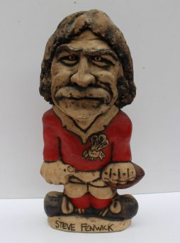 A John Hughes pottery Grogg of Steve Fenwick, in a red Welsh jersey, No.12 to the reverse, signed to the base, 34.5cm high. Sold for £580 at Anthemion Auctions