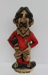 """A John Hughes pottery Grogg titled """"David the Dash"""" in a red Welsh jersey with No.11 on the reverse, signed and dated 1976, 33cm high. Sold for £100 at Anthemion Auctions"""
