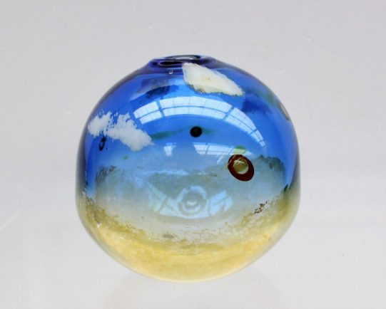 A Norman Stuart Clarke art glass vase of spherical shape and cloud patterns to a blue and green ground, signed and dated '92 to the base, 11cm high. Sold for £30 at Anthemion Auctions
