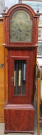 An E J Goodfellow of Wadebridge long case clock together with a replica of the sword of Charlemagne, a gilt wall mirror and another wall mirror