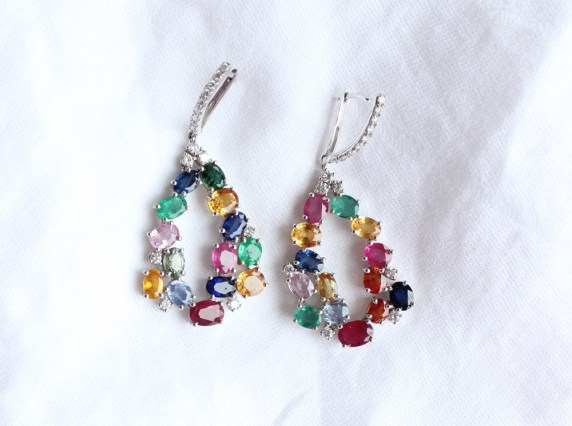 A pair of Cartier 'Tutti Frutti' style drop earrings, set with rubies, sapphires, emeralds and diamonds in a white metal setting, approximately 5cm drop x 2cm wide, approximately 17.5 grams. Sold for £2,000 at Anthemion Auctions
