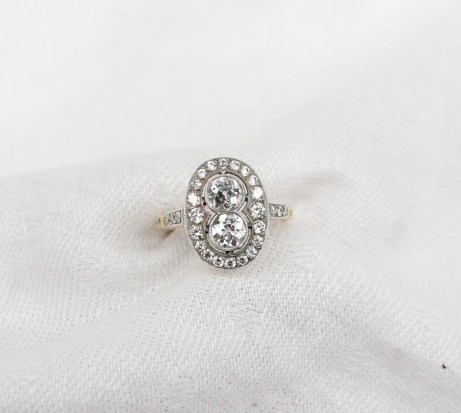A diamond dress ring, set with two round old cut diamonds each approximately 0.25ct, surrounded by twenty round old cut diamonds to a white metal setting and yellow metal shank. Sold for £1,950 at Anthemion Auctions