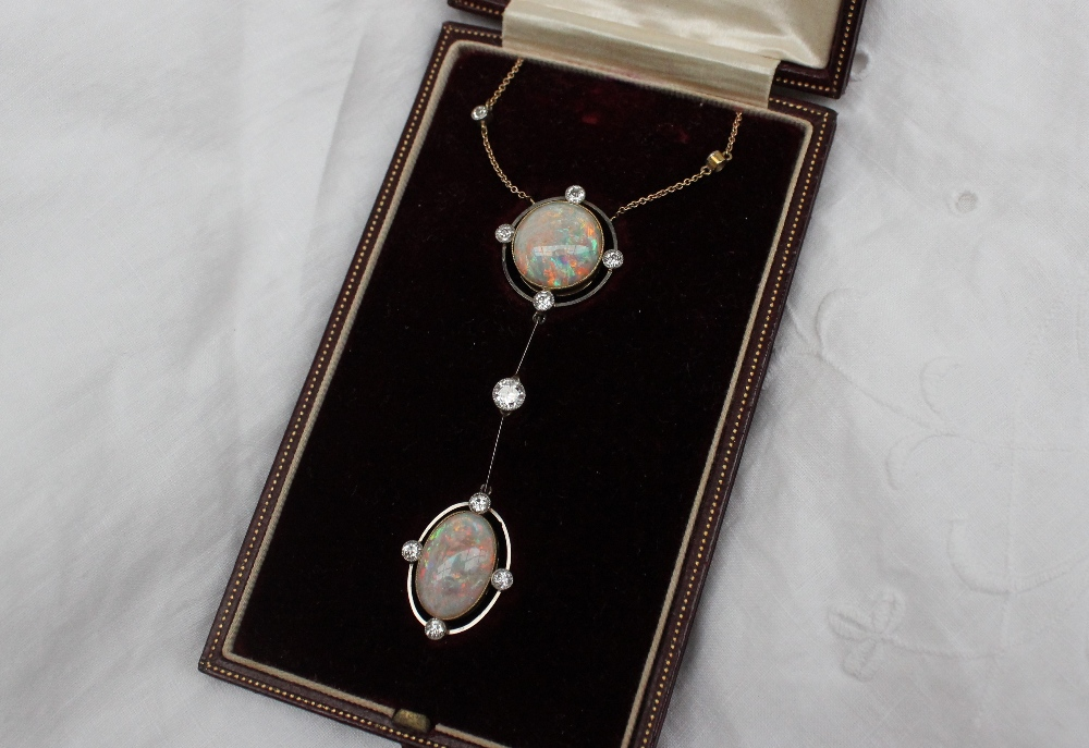An early 20th century opal and diamond necklace, set with a large circular cabochon opal and a large oval cabochon opal and eleven round old cut diamonds to a 15ct yellow gold setting and chain, in a Spiridion & Son of Cardiff tooled gilt red leather box. Sold for £1,400 at Anthemion Auctions