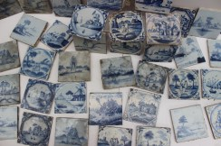 A collection of blue and white delft tiles, depicting cottages, figures etc. Sold for £1,100 at Anthemion Auctions