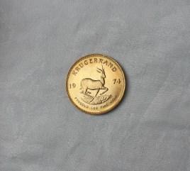 Lot 147 - Estimates: £800 - 1,000. A 1974 gold South African Krugerrand