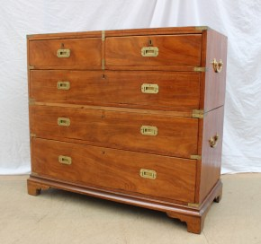 Lot 552 - Estimates: £300 - 500. A 19th century mahogany chest of drawers converted into a two section campaign chest with brass carrying handles, the rectangular top above two short and three long drawers with inset brass handles, brass dividers and corners, on bracket feet, 10-6.5cm wide x 47.5cm deep x 97.5cm high