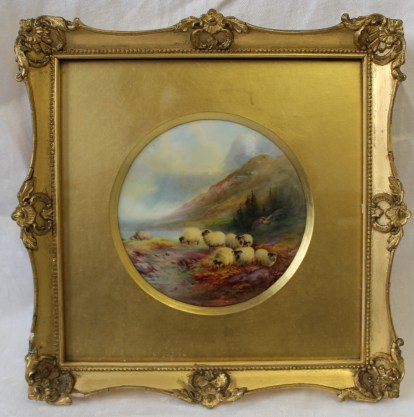 A Royal Worcester porcelain plaque of circular form, painted with sheep by a lock with mountains beyond, signed by Harry Davis, puce mark and date code for 1915, in a gilt frame, 10.5cm diameter. Sold for £1,400 at Anthemion Auctions