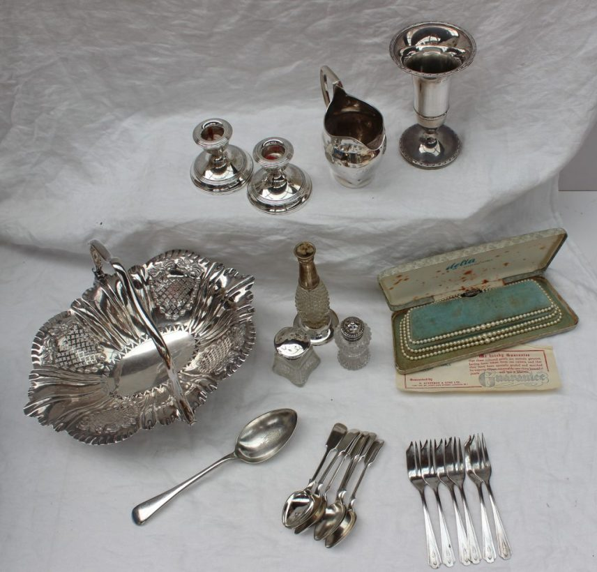 22nd August - Silver Lot 231. A George III silver cream jug, London, 1802, together with a silver vase, silver desk candlesticks, silver topped salt, silver topped scent bottle, cultured pearls and epns, weighable silver approximately 100 grams