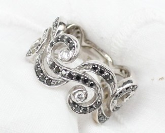 """22nd August Fine Sale - Jewellery Lot 103. A black and white diamond eternity ring of """"S"""" scroll design to an 18ct white gold setting approximately 7.5 grams. Sold for £120 at Anthemion Auctions"""