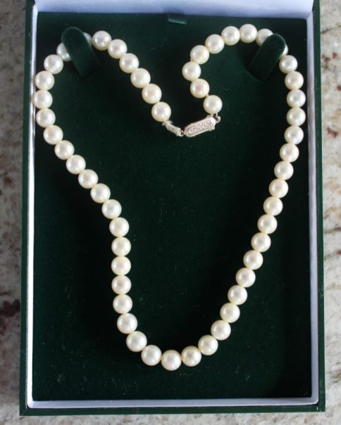 A pearl necklace with fifty four regular pearls to a 9ct yellow gold clasp, approximately 41cm long. Sold for £65 at Anthemion Auctions