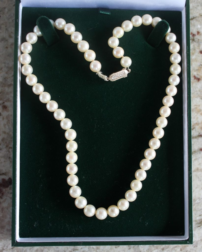 22nd August Fine Sale - Jewellery Lot 66. A pearl necklace with fifty four regular pearls to a 9ct yellow gold clasp, approximately 41cm long