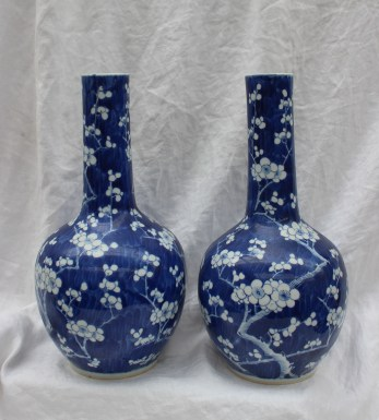 22nd August - Asian Ceramics Lot 303. A pair of Chinese prunus blossom bottle vases, with a cylindrical neck and bulbous base, four character script mark to the base, 36cm high