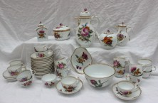 22nd August - Continental Ceramics Lot 313. A Meissen porcelain part tea and coffee service, with a gilt rim each piece painted with various sprays of garden flowers, comprising eighteen saucer dishes approximately 13cm diameter, twelve tea cups, six coffee cans, a slops basin, tea caddy, sucrier and cover, oval dish, teapot, coffee pot and hot water jug, each bear the underglazed blue crossed swords and asterisk mark