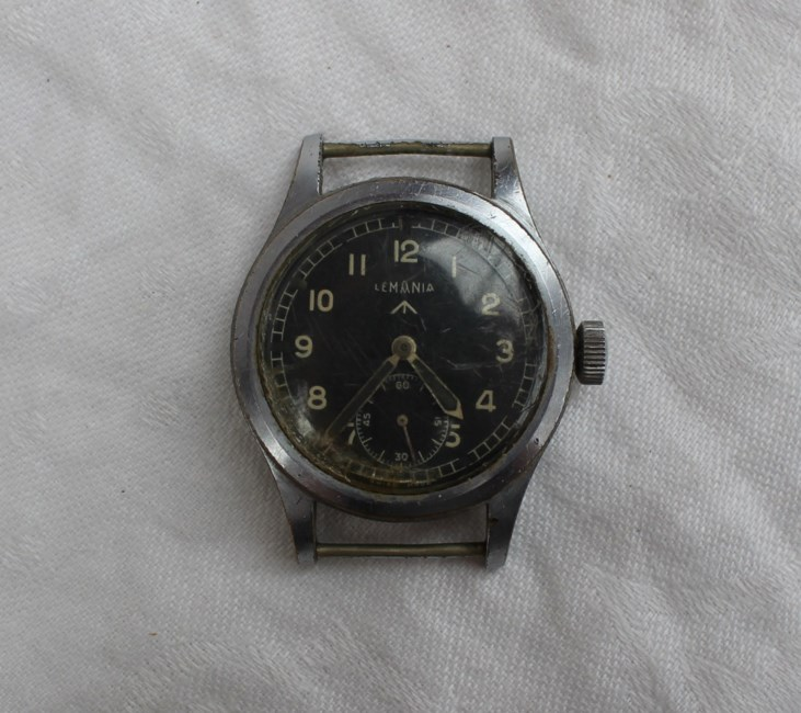 """Sold for £820. A Gentleman's British Military Lemania W.W.W. wristwatch part of the """"DIRTY DOZEN"""" Movement: Manual wind, case diameter approx. 36mm, fixed bars, nickel plated case with steel screw back, issue markings Q2943 ^ W.W.W. *4495, 4493, lug numbered 733, movement marked 27A"""