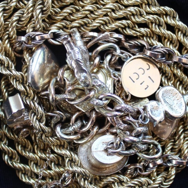 Sold for £730. An 18ct gold rope twist necklace, approximately 23 grams together with a 9ct gold charm bracelet set with numerous charms including a heart shaped locket, top hat, baby carriage etc and another 9ct gold bracelet approximately 41.5 grams