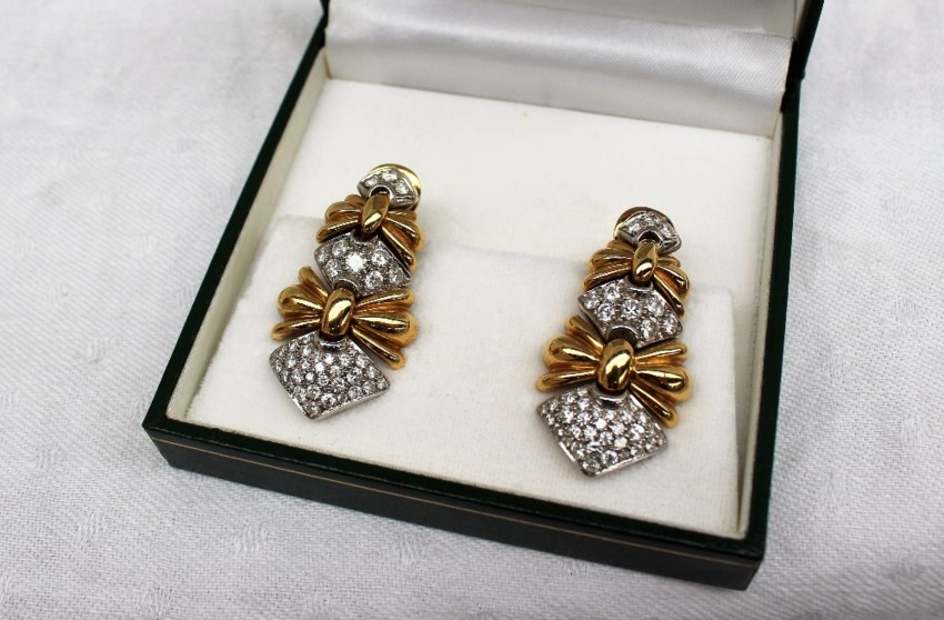 Sold for £640. A pair of Italian 18ct yellow gold and diamond set earrings, set with round brilliant cut diamonds to a yellow and white gold setting, approximately 20.9 grams