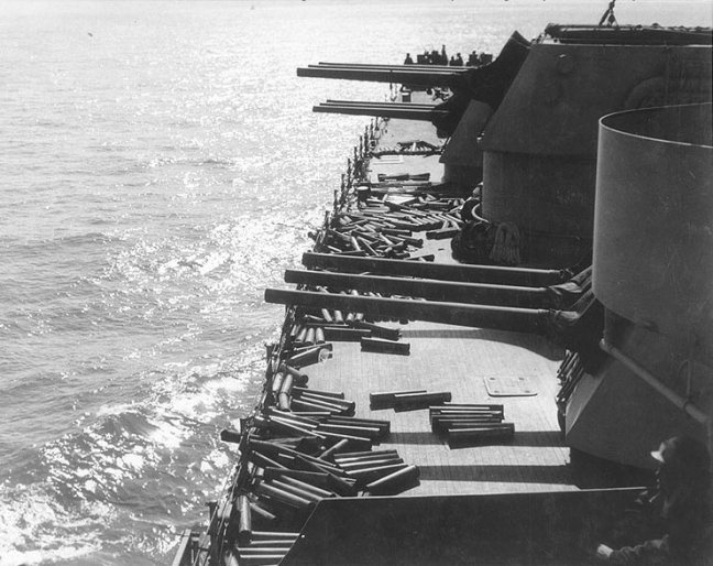 Guns_and_shell_casings_on_board_USS_Brooklyn_(CL-40)_during_Sicily_invasion,_July_1943