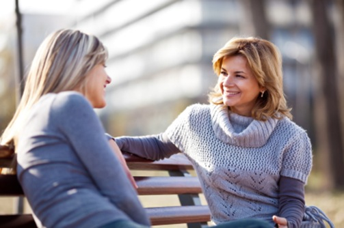 friends-talking-on-a-bench