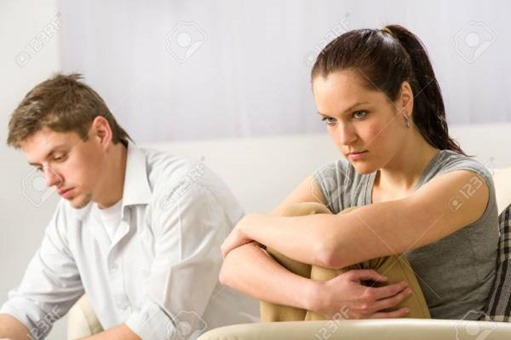 Unhappy-couple-sitting-on-couch-silently-after-argument