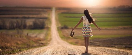 Lonely-Girl-Walking-On-Road
