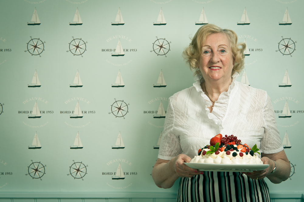 Portrait of Mrs Makepiece and her pavlova she once served to Audrey Hepburn