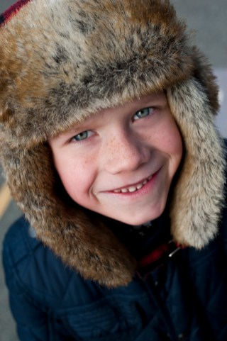 Boy in fir lined hat