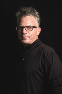 Richard B. Liebowitz wearing black in front of a black backdrop
