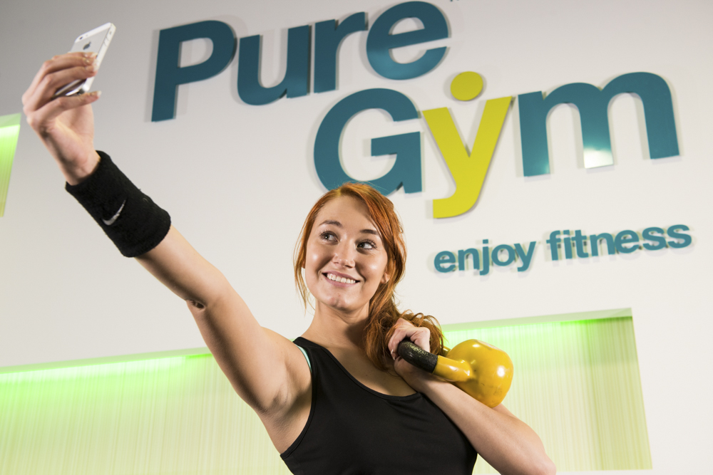 Model taking a selfie for PureGym