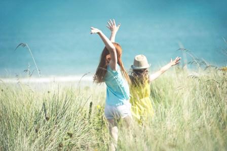 Girls running in the sun