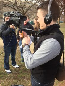 Students test out gear before covering the inauguration