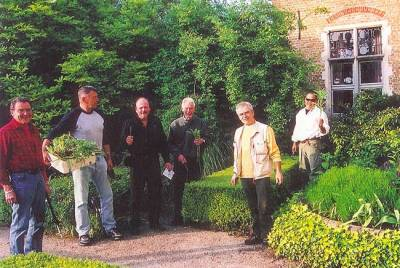 "2005. The guys cleaning up the formal garden at The English Convent in Bruges, Belgium. This was ""home base"" for a two week painting trip."