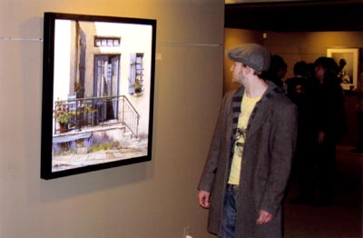 "2010. A visitor with Tony's ""Aegean Blue"" at Toronto's Roberts Gallery."