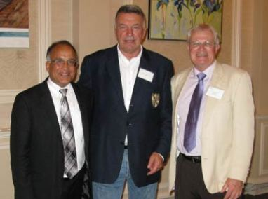 September, 2012. Leonard Preyra, Nova Scotia's Minister of Communities, Culture and Heritage, Tony and Ed Huner, curator of the SCA's major members exhibition at the Halifax Club.
