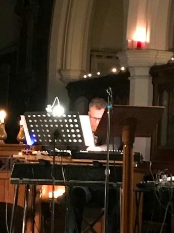 Alastair behind music