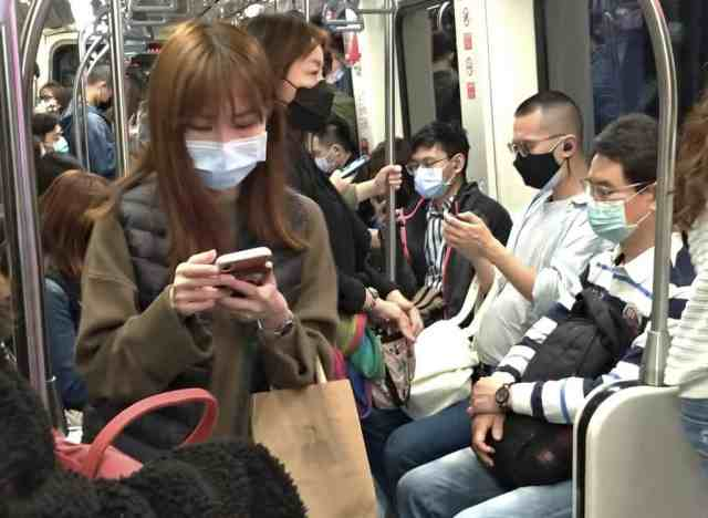 people wearing masks on MRT