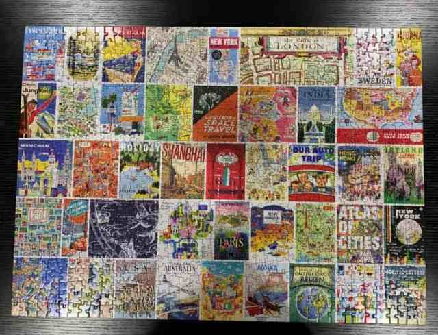 A completed puzzle of what seem to be old travel posters or book covers.