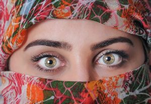 Woman with a multicolored head scarf with only the eyes showing