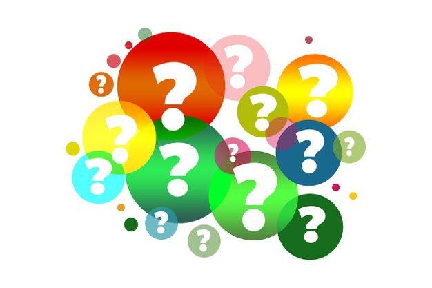 Question marks inside multicolored bubbles