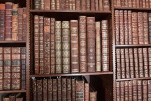 Brown books on a bookshelf