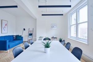 A white table with blue chairs