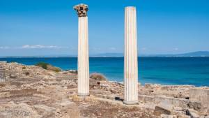 White pillars with a blue sea in the background