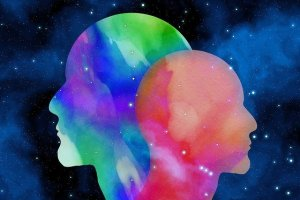 Multicolored silhouettes of 2 heads
