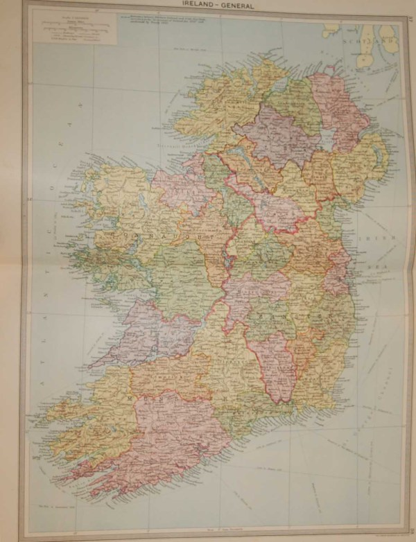 Large vintage colour map from 1930 of Ireland counties are highlighted by colour sets on a per province basis. Provinces distinguished by red border. The border is highlighted using broken black dots.